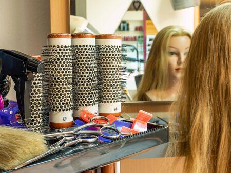Hair salon Blonde woman cutting hair in salon