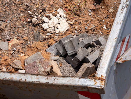 Building rubble in container renovation construction site