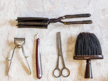 Antique tool in hairdressing craft background