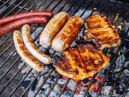 Barbecue with sausage and steak in the garden