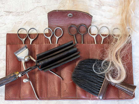 Antique barber scissors with hairdressing tool Stock fotó