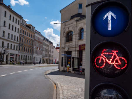 Bicycle traffic light stands on red in the city