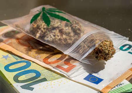 Bag of cannabis and euro bills