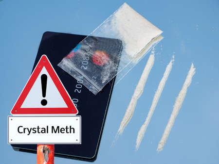 crystal meths line with money card and bag danger Warning Sign Foto de archivo