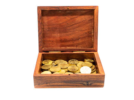 Treasure chest with coins isolated on white background
