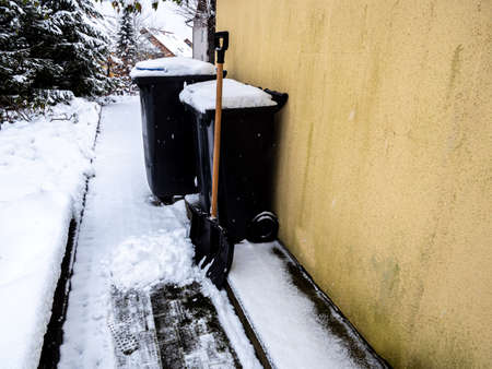 Clear snow away from the garbage cans