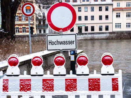Caution flood warning sign due to melting snow Stock Photo