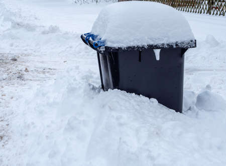 Garbage can completely snowed in in the snow chaos