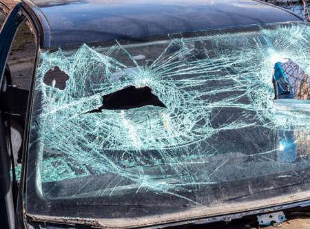broken windshield of a car after vandalism