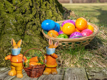 Easter basket with colorful Easter eggs and bunnies