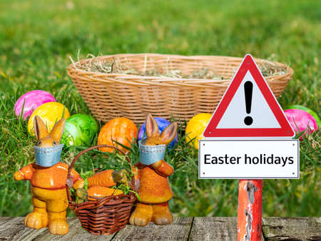 Warning sign Easter holidays with Easter bunny and basket