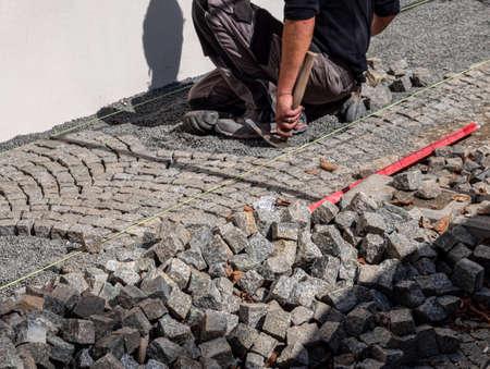 Paving work on the sidewalk 免版税图像