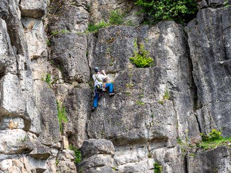 Climbing rock with climbers in Franconian Switzerland 免版税图像