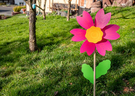 Colorful windmill stands in the garden
