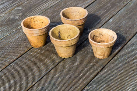 old plant pots are in the garden