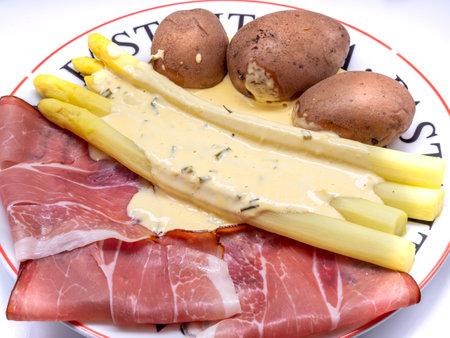 Asparagus with ham in the asparagus season