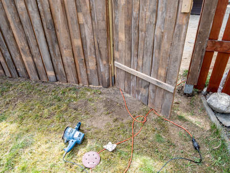 Grinding machine for grinding the garden fence Standard-Bild