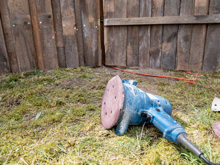 Wood grinder for sanding a fence