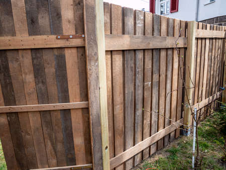 New fence is being built in the garden Standard-Bild