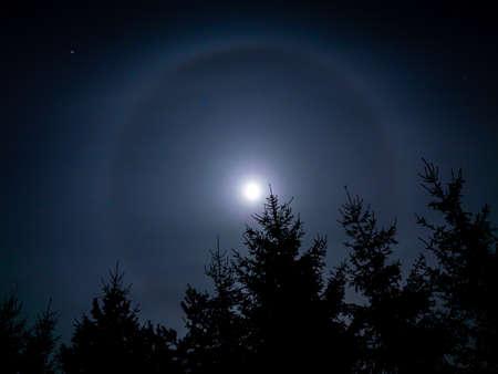 Halo light effect around the moon Standard-Bild