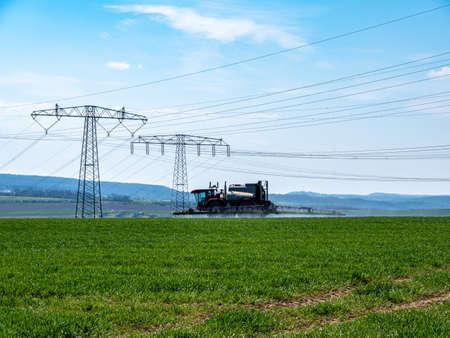 Tractor sprays pesticide on a field