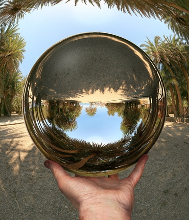 Glass sphere in hand, photocollage (a lot of my shots as a source). Vai Beach. Crete. photo