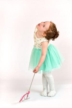 catwalk model: Fashion little girl in green dress, in catwalk model pose, stock photo. Image 04