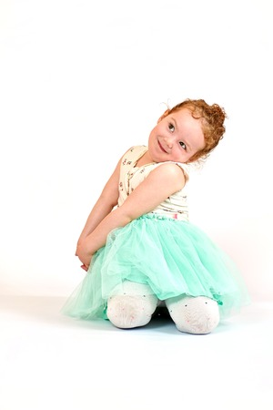 catwalk model: Fashion little girl in green dress, in catwalk model pose Stock Photo