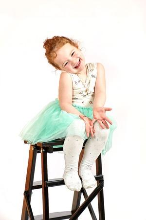catwalk model: Fashion little girl in green dress, in catwalk model pose, stock photo. Image 08