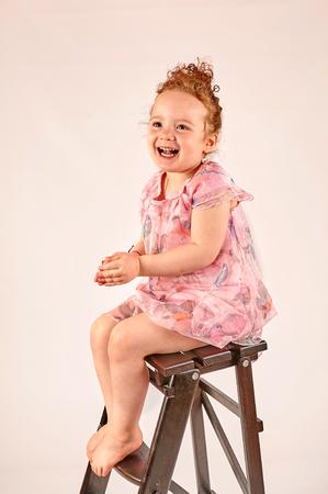 catwalk model: Fashion little girl in rose dress, in catwalk model pose, stock photo