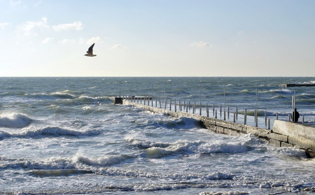 Sea wave splashing against a pier in Odessa. Black Sea.