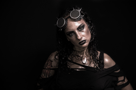 Portrait of Brutal Steampunk Girl over Black Background