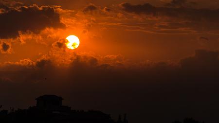 crimson sunset and the fiery sun