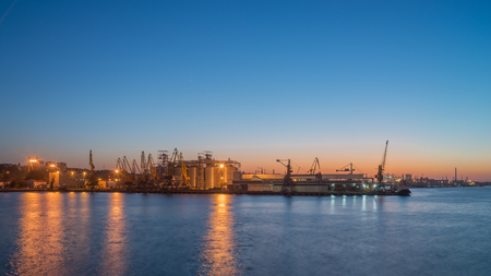 ODESSA, UKRAINE - 06.19.2018. Panoramic view of sea port and cargo terminal from the side of the sea terminal at summer sunset Editorial