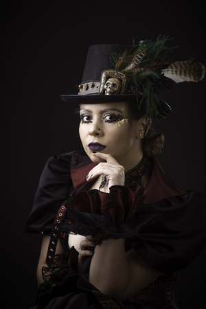 Emotional Portrait of Young Woman in Steampunk or Retro style. Studio shot. Model on a Black Background 版權商用圖片