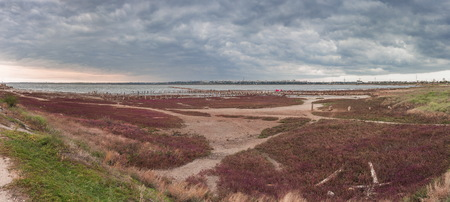 Storm clouds over the Kuyalnik Salty drying estuary in Odessa, Ukraine Stock Photo