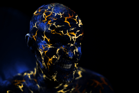 Conceptual Portrait of a man painted in fluorescent UV colors and looks like Neon lava