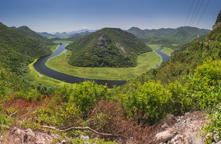 Panoramic view from above of the huge bend of Tsrnoyevicha river and the forest around, Rijeka Crnojevica in Montenegro Stock Photo