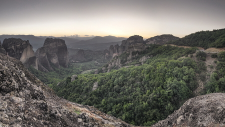 Panoramic sunset view of the Meteora  Monasteries near Kalambaka town in Greece Imagens
