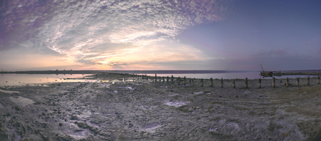 Sunset clouds over a drying salt lake 写真素材