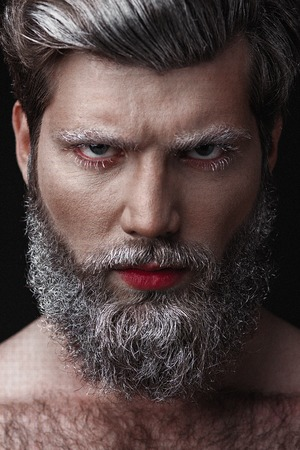 Creative Portrait of grey-haired fashionable man with red lips and tongue Banco de Imagens