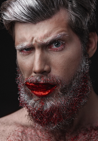 Creative Portrait of grey-haired fashionable man with red lips and tongue Imagens