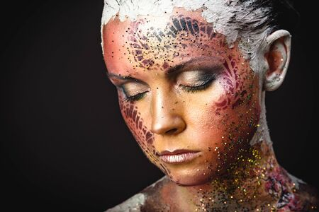 Portrait of Beautiful Young Woman with creative fantasy bird makeup
