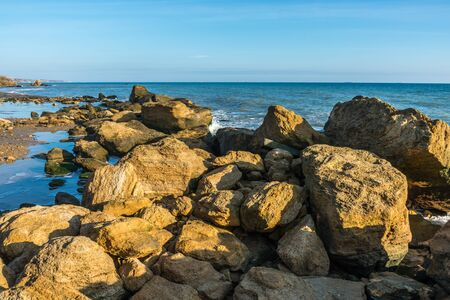Big stones on the edge of the Black Sea. Autumn day by the sea near the village of Fontanka, Odessa region, Ukraine