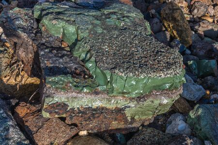 Petrified liquid glass in stone by the sea Imagens