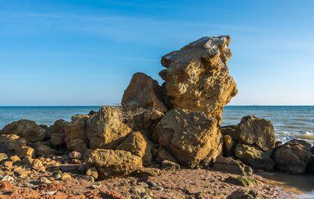 Huge stone by the sea on a Sunny autumn day on the seashore near the village of Fontanka, Odessa region, Ukraine