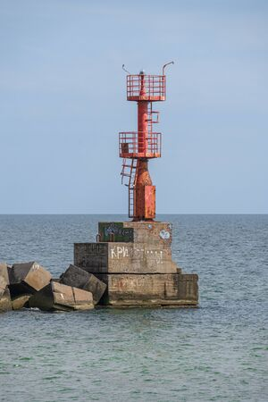 Grigoryevka, Ukraine - 05.09.2019. The lighthouse at the entrance to Adzhalyk estuary from the Black Sea. Sea gate to the South Trade Port in Ukraine