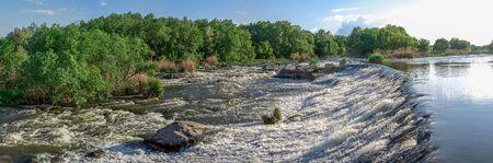 Power station dam on the Southern Bug River near the village of Migiya, Ukraine, on a sunny summer day Standard-Bild