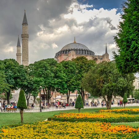 Istambul, Turkey – 07.12.2019. The Sultan Ahmad Maydan water fountain with the Hagia Sophia museum in background on a cloudy summer day, Istanbul, Turkey Editorial