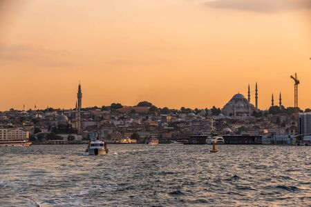 Istambul, Turkey – 07.12.2019. Panoramic view from the sea to the city of Istanbul at sunset
